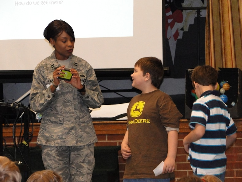 Capt. Catercia Isaac talks to Bel-Aire Elementary students about how AEDC has tested the Global Positioning Satellite (GPS). To demonstrate the GPS, the captain showed them a GPS unit used in many vehicles. (Photo provided)