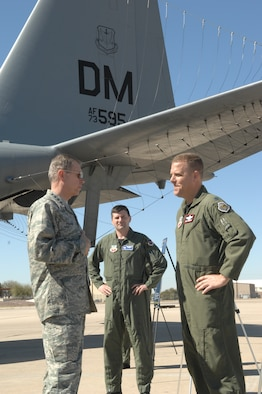 Gen. William M. Fraser III speaks to Lt. Col. Marty Reynolds (center), and Lt. Col. Bob Stonemark (right) on the flightline during his tour of Davis-Monthan Air Force Base, Feb. 23, 2010. General Fraser is the commander of Air Combat Command. Colonel Reynolds is the 42nd Electronic Combat Squadron commander. Colonel Stonemark is the 43rd Electronic Combat Squadron commander. (U.S. Air Force photo/Staff Sgt. Alesia Goosic)