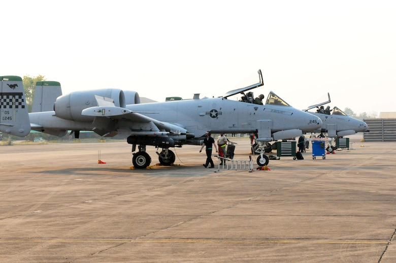 A-10 Thunderbolt II crew chiefs and weapons loaders prepare their Osan Air Base, South Korea, jets for shutdown after their return from a Cope Tiger 2010 training mission at Udon Thani Royal Thai Air Force Base, Thailand, on March 5.  Cope Tiger is an annual, multilateral aerial large force exercise conducted in Thailand that includes humanitarian and civic assistance programs. This year?s exercise takes place primarily at Udon Thani and Korat Royal Thai Air Force Bases. (U.S. Air Force photo/Tech. Sgt. Cohen A. Young)