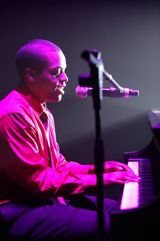 """1st Lt. John Early, a 10th Missile Squadron ICBM combat crew commander, performs Bruce Hornsby's """"The Way It Is"""" at the Air Force Worldwide Talent Contest at Lackland Air Force Base, Texas. Of 74 contestests, he was one of 31 selected for the 2010 Tops and Blue team. (Courtesy photo)"""