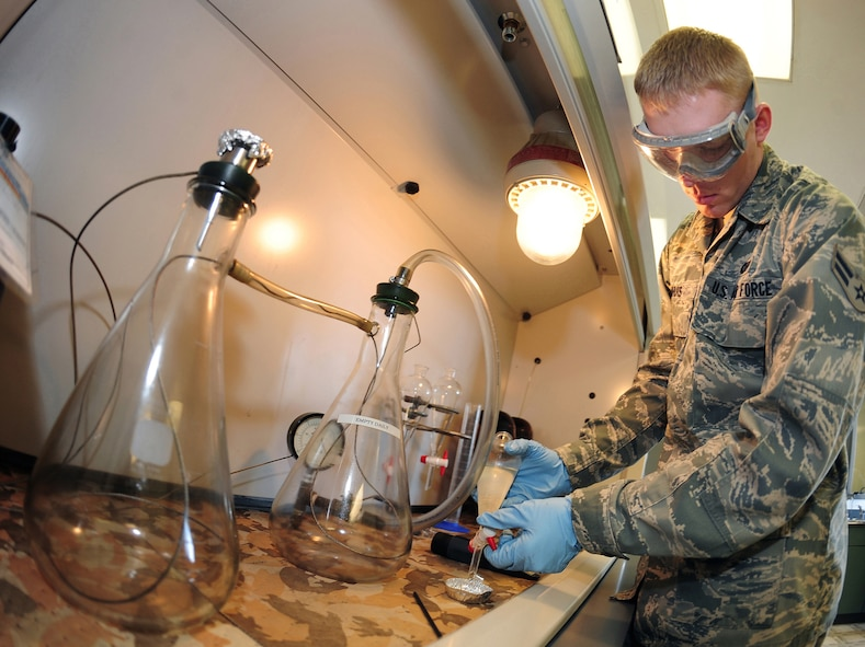 OFFUTT AIR FORCE BASE, Neb. - Airman 1st Class Edward Damhuis, a fuels labratory technician, performs tests in the Fuels Management Flight's fuels information center laboratory here March 1. The laboratory tests fuel for various things including the level of Fuel System Ice Inhibitor additive. U.S. Air Force photo by Josh Plueger