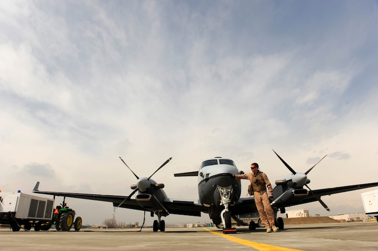Lt. Col. Douglas J. Lee, 4th Expeditionary Reconnaissance Squadron commander, performs a walk-around inspection of an MC-12W prior to boarding it for a mission, Feb. 27, 2010, at Bagram Airfield, Afghanistan.  The MC-12 program was dubbed the Project Liberty Program as a nod to a World War II effort that quickly built and transitioned commercial ships to the fight in Europe, much like how the Air Force fielded  the MC-12.  (U.S. Air Force photo/Staff Sgt. Manuel J. Martinez/released)
