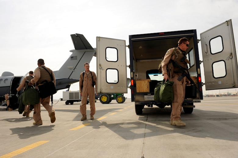 An MC-12W Liberty aircrew assigned to the 4th Expeditionary Reconnaissance Squadron, prepares to board an MC-12W for a mission Feb. 27, 2010, at Bagram Airfield, Afghanistan.  Since the 4th Expeditionary Reconnaissance squadron stood up in December 2009, the all-volunteer unit known as the ?Crows? has flown 130 sorties, logging more than 600 hours.  (U.S. Air Force photo/Staff Sgt. Manuel J. Martinez/released)