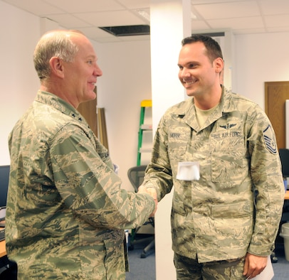 RAMSTEIN AIR BASE, Germany – Maj. Gen. Ronald Ladnier, 17th Air Force commander, congratulates Senior Master Sgt. (select) David Morse on his selection for promotion March 4. Sergeant Morse is the 617th Air and Space Operations Center NCO in charge of the Air Mobility Division. Six master sergeants from 17th AF were selected for promotion to senior master sergeant. (U.S. Air Force photo by Staff Sgt. Stefanie Torres)