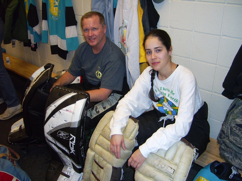 "Fellow goalies for the 103rd Airlift Wing hockey team, Master Sgt. Michael Johnson and Senior Airman Natalie Ayala, prepare to put their game faces on in the locker room at MassMutual Center in Springfield, Mass., before taking on the rival 104th Fighter Wing Feb. 13, 2010. The 103rd's Flying Yankees skated to a decisive 5-3 win over the Barnes Stormers in the classic matchup. (Photo courtesy of Master Sgt. Michael ""DJ"" Johnson)"