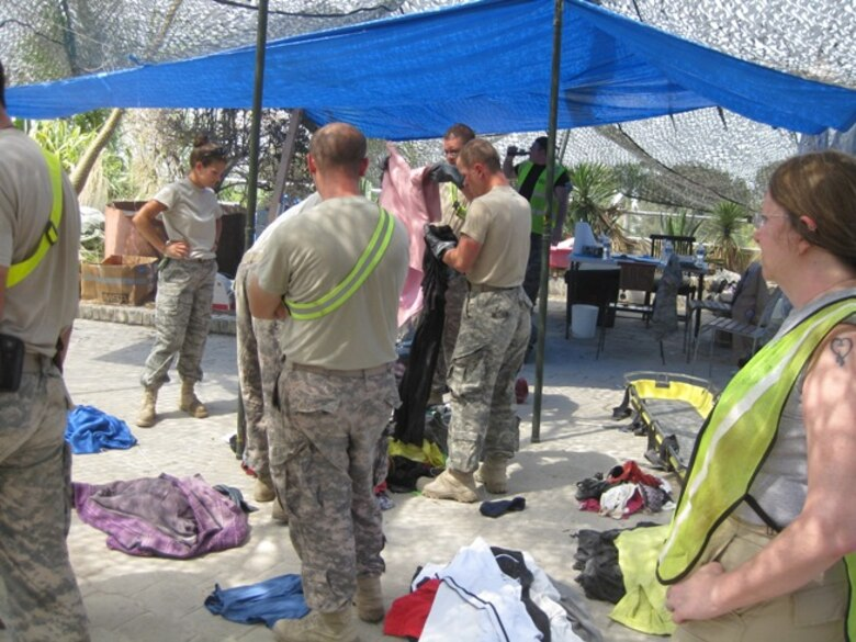 Connecticut's own Master Sgt. Melissa Letizio, noncommissioned officer in charge of billeting, 24th Air Expeditionary Group, helps other search and recovery personnel sort personal affects found at the Hotel Montana site in Port-au-Prince, Haiti. (Photo courtesy of TSgt. Bambi Putinas)