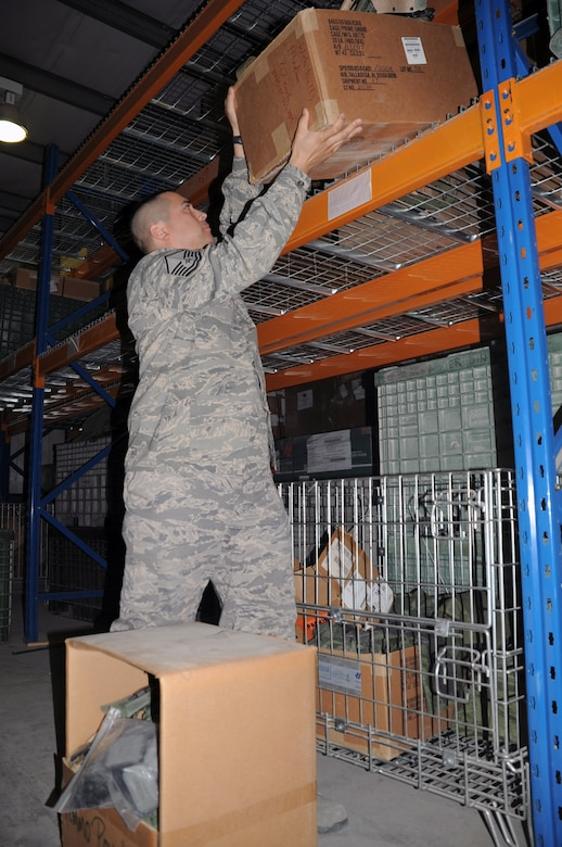 Master Sgt. Alex Brown moves boxes in the supply warehouse for the 380th Expeditionary Logistics Readiness Squadron at a non-disclosed base in Southwest Asia on March 6, 2010. Sergeant Brown is the superintendent of the ?Desert Depot,? otherwise known as the base supply store. Brown is a career material management Airman deployed with the 380th ELRS. He is deployed from the 161st Air Refueling Wing at Phoenix Sky Harbor Air National Guard Base, Ariz., and his hometown is Tolleson, Ariz. (U.S. Air Force Photo/Master Sgt. Scott T. Sturkol)