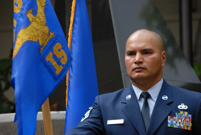 Master Sgt. Marcus Della Sala holds the unit flag during the 201st Intelligence Squadron's unit actvation ceremony at the Courtyard of Heroes, PACAF Headquarters, Joint Base Pearl-Harbor-Hickam AFB, HI. March 7, 2010.  (U.S. Air Force Photo, A1C Orlando Corpuz)