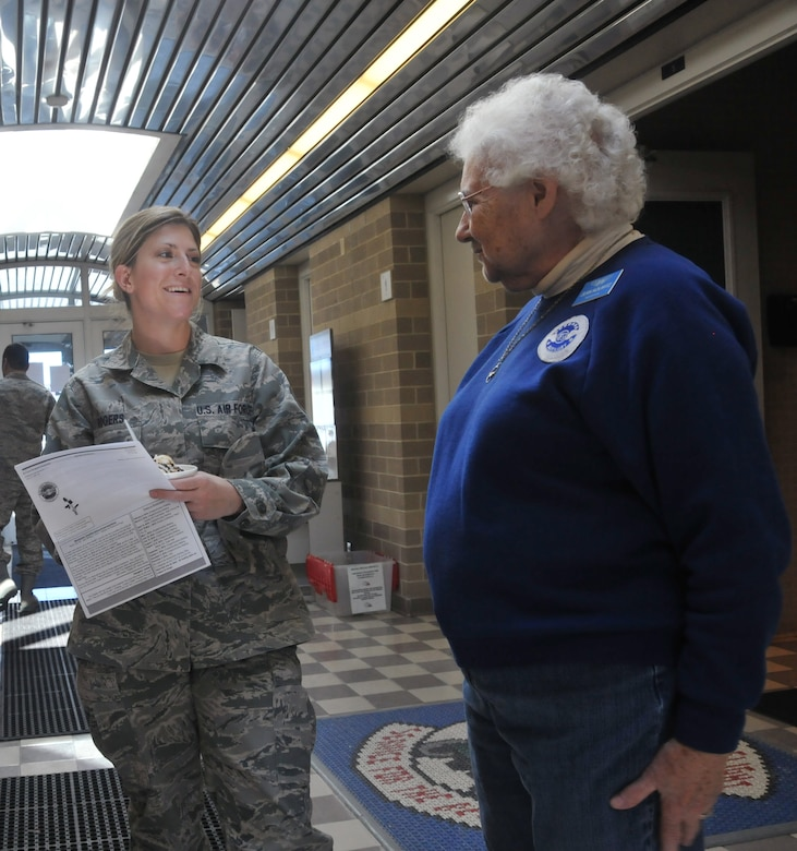 Tech Sgt Courtney Rodgers, a 128 ARW intelligence analyst, receives information about the Air Force Sergeants Association from Jean Kolwitz, a senior advisor for Auxiliary Chapter 851 of AFSA, on Saturday, March 6, 2010.  Members of Auxiliary Chapter 851 were at Sijan Hall to raise funds for their programs involving the shipment of care packages to Airmen deployed or stationed overseas.  (U.S. Air Force photo by Staff Sgt Nathan Wallin/released)