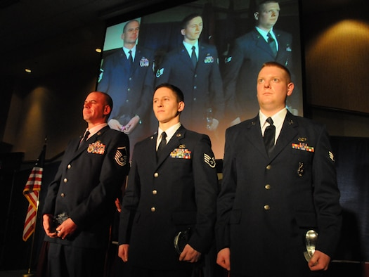 Master Sgt. Shane J. Amundson, Staff Sgt. Wesley J. Heit and Senior Airman Erik R. Foss stand on stage during the Outstanding Airman of the Year Banquet for the 119th Wing, North Dakota Air National Guard that took place on Saturday, March 6, 2010.  Amundson received the honor of Senior Non-Commissioned Officer of the Year, Heit received the honor of Commissioned Officer of the Year and Foss received the honor of Airman of the Year.
