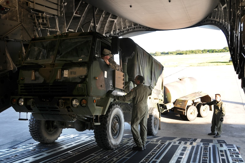 Members of the Hawaii Air National Guard help unloadsupplies in support of Operation United Command, January 21, 2010. (Air Force Times photo/Sheila Vemmer)