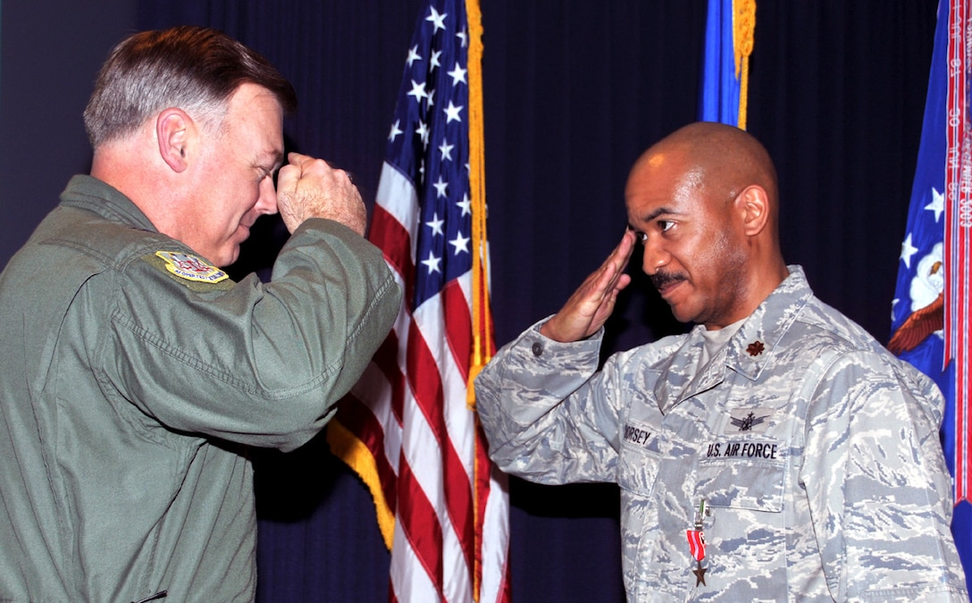 Air Force Operational Test and Evaluation Center Commander Maj. Gen. Stephen T. Sargeant presents the Bronze Star to Maj. Hamilton L. Dorsey for his actions while deployed to Iraq during a Feb. 5, 2010 AFOTEC Commander's Call at Kirtland Air Force Base, N.M.
