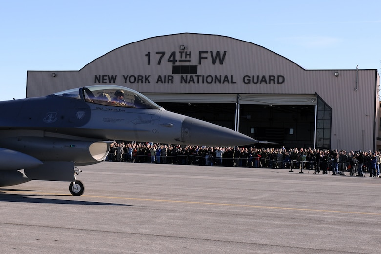 174th Fighter Wing Commander Colonel Kevin W. Bradley taxis past assembled family, friends and distinguished visitors for the last time with the F-16 at Hancock Field Air National Guard Base. The 174th Fighter Wing has converted to the MQ-9 Reaper and began flying 24/7 operations in support of Operation Enduring Freedom on 1 December 2009. (US Air Force photo by Staff Sgt James N. Faso II/Released)