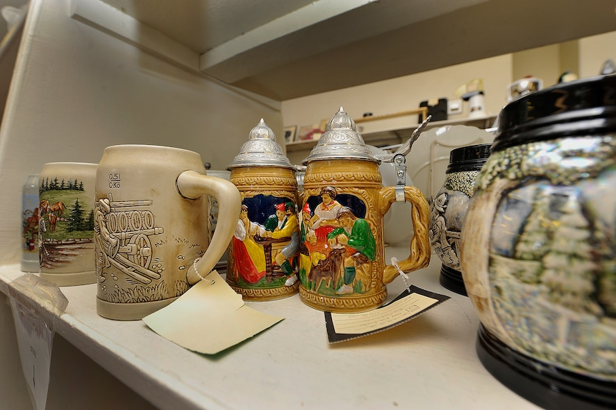 The Peterson Thrift Shop, owned and operated by the Peterson Spouses' Club, is a fun place to browse, since consignors and donors are active and retired military families who bring in items they have collected from around the country and the world. These German mugs and steins are on sale at the shop. (U.S. Air Force photo/Rob Bussard)