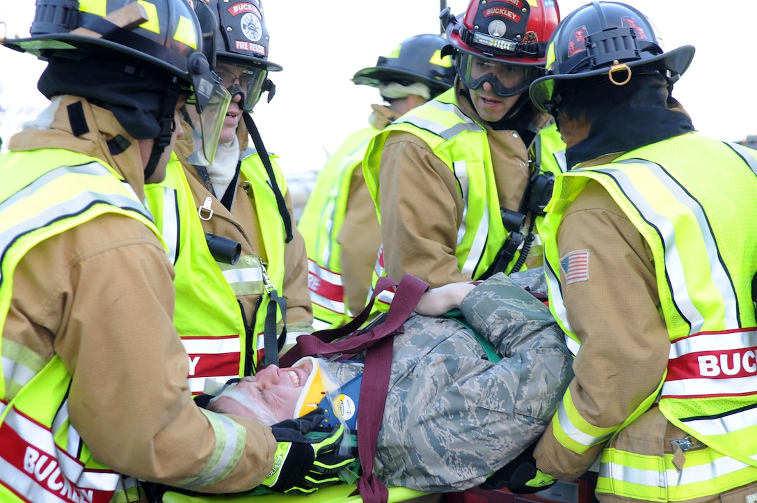 BUCKLEY AIR FORCE BASE, Colo. -- 460th Civil Engineer Squadron firefighters respond to an exercise car accident Feb. 25 as part of the Operational Readiness Inspection. (U.S. Air Force Photo by Airman First Class Marcy Glass)