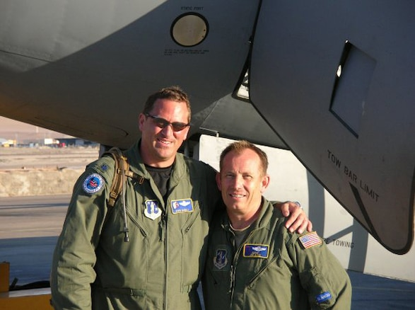 Lt. Col. Boyd Badali and Senior Master Sgt. Joe Mace of the 151st Air Refueling Wing, Utah Air National Guard, pose in front of a Chilean KC-135E. The two are deployed to Santiago, Chile, along with three other Utah ANG members to train  Chilean Air Force pilots, boom operators and maintainers on how to operate the aircraft. Shortly after deploying, the training mission transformed into a humanitarian operation to help support the country's earthquake efforts. U.S. Air Force photo by Lt. Col. Boyd Badali