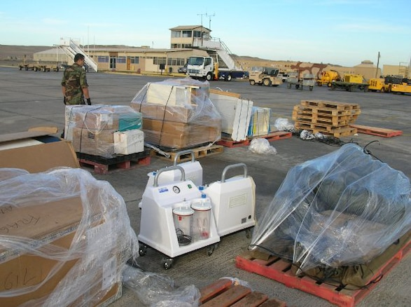 Several pallets of medical supplies sit on the runway of the airport in Santiago, Chile. Utah Air National Guard crews prepare to transport the supplies to locations throughout the country in support of earthquake humanitarian operations. U.S. Air Force photo by Lt. Col. Boyd Badali