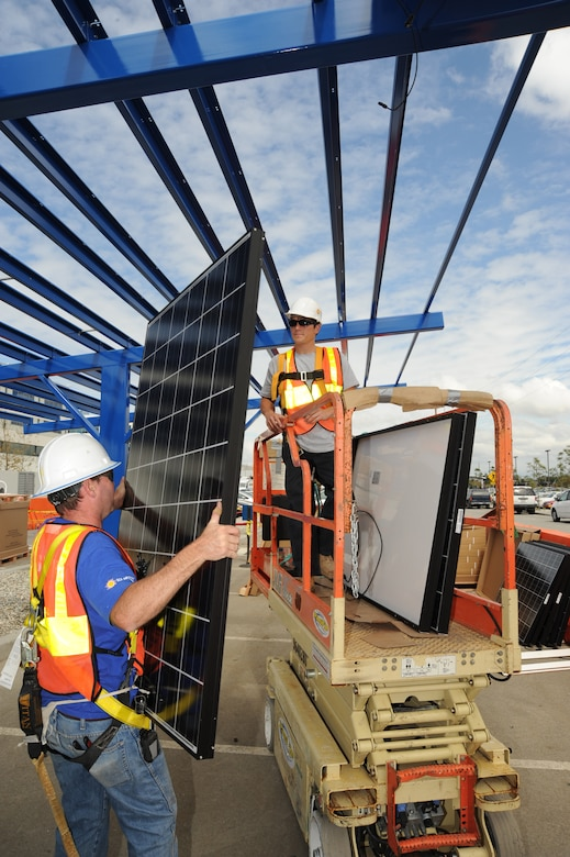 Work continues on the solar panels being installed on Los Angeles Air Force Base. When completed, the panels will decrease the amount of electricity the base purchases from the power company. A similar project on the roof of the base commissary converts sunshine into about 290 kilowatt-hours of electricity each day, enough to power 10 typical households.  (Photo by Lou Hernandez)