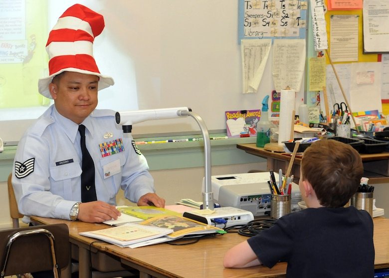 Tech Sgt. Jessie Gregorio reads to a class of students during the Read Across America event at Eshelman Avenue Elementary School, March 2.  The tech sergeant attended the school as an elementary school student.  (Photo by Jim Gordon)