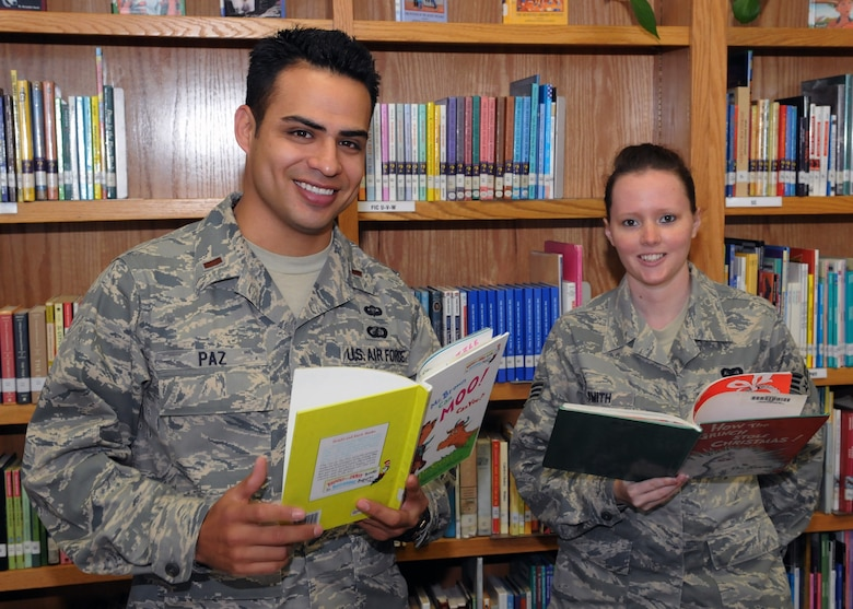Lt. Rick Paz and Senior Airman Elissa Smith select a book to read to students during the Read Across America event at Eshelman Avenue Elementary School, March 2.  (Photo by Jim Gordon)
