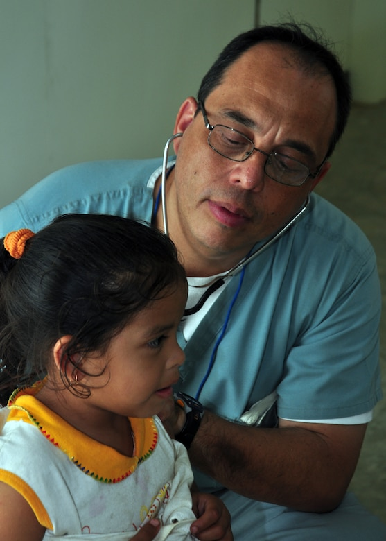 Doctor Guillermo Saenz, Joint Task Force-Bravo Medical Element, checks a Belizean child for respiratory problems during medical readiness training exercise in Armenia, Belize March 3. From March 1-4 the MEDRETE team, from Soto Cano Air Base, Honduras, saw more than 630 individual s with medical problems ranging from colds to stroke victims. (U.S. Air Force Photo/Staff Sgt. Bryan Franks)