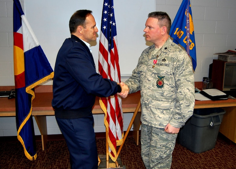 On Saturday, March 6th, Lt. Colonel Gregory Staut, Commander of the 140th Civil Engineering Squadron, was presented with the Bronze Star by 140th Wing Commander Brig. Gen. Trulan Eyre.  Staut received the medal for duties performed in support of Operation Iraqi Freedom as commander of Facility Engineering Detachment 4, 732nd Air Expeditionary Group, 332nd Air Expeditionary Wing, Balad Air Base, Iraq. (Air Force Photo by Master Sgt. Rochell Smith, 140th Wing Public Affairs)