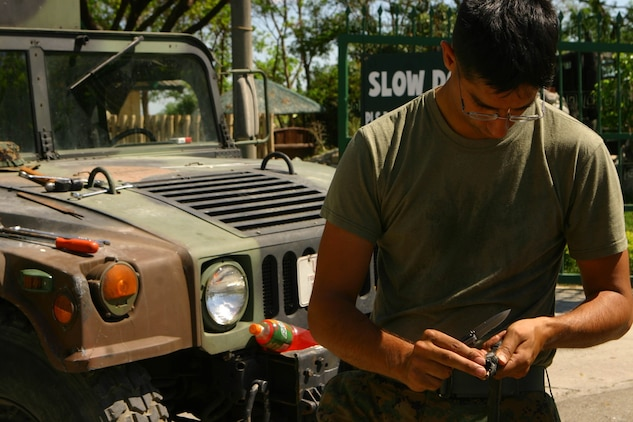 Sgt. Scott Terriquez, light-armored vehicle (LAV) technician with Combat Logistics Battalion 31 (CLB-31), 31st Marine Expeditionary Unit (MEU), shortens a welding cable during a gate repair, March 11. The MEU is currently participating in Exercise Balikatan 2010 (BK '10). Servicemembers from the Armed Forces of the Philippines (AFP) and the 31st MEU are training together during BK '10 to hone their civil-military interoperability skills to ensure more responsive, efficient and effective relief efforts. (Official Marine Corps photo by Cpl. Michael A. Bianco)