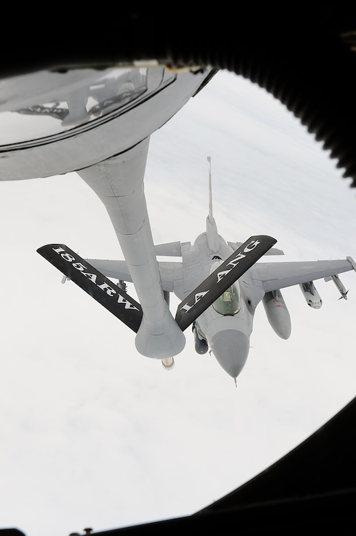 An F-16 assigned to the Texas Air National Guard's 149th Fighter Wing at Lackland Air Force Base, Texas, approaches a KC-135 assigned to the Iowa Air National Guard's 185th Air Refueling Wing for in-flight refueling, over South Texas, on March 6, 2010. (U.S. Air Force photo by Tech. Sgt. Rene Castillo/Released)