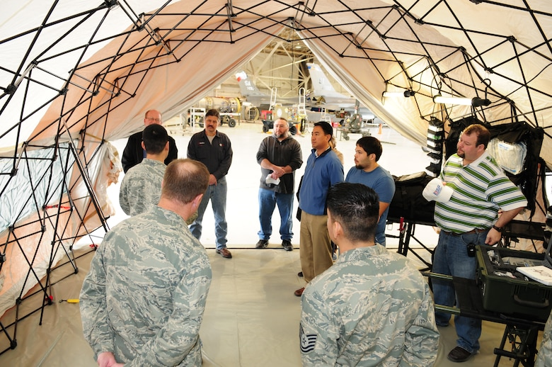 "Members of the Texas Air National Guard's 149th Fighter Wing explain the medical capabilities that are used during humanitarian and disaster relief missions to a group of civilian employers of Air National Guard members, as part of a ""Boss Lift,"" which was coordinated with the Employer Support for the Guard and Reserve, at Lackland Air Force Base, Texas, on March 6, 2010. (U.S. Air Force photo by Tech. Sgt. Rene Castillo/Released)"