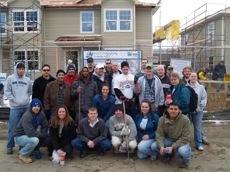 BUCKLEY AIR FORCE BASE, Colo. -- Volunteers from the 566th Intelligence Squadron pose for a group photo at the site of a Habitat for Humanity home build Feb. 12. The 566th IS is a tenant unit on Buckley Air Force Base. (U.S. Air Force photo)