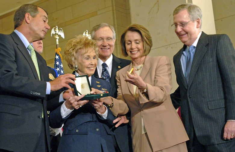 Deanie Parrish, one of the World War II Women Airforce Service Pilots and associate director of Wings Across America, accepts the Congressional Gold Medal on behalf of her fellow WASPs at the Capitol March 10, 2010. Presenting the medal are Speaker Nancy Pelosi, Rep. John Boehner, Sen. Harry Reid and Sen. Mitch McConnell. More than 200 WASPs attended the event, many of them wearing their World War II-era uniforms. (U.S. Air Force photo/Staff Sgt. J.G. Buzanowski)