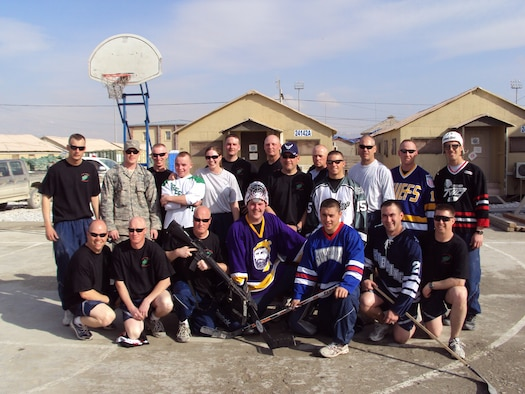 148th Fighter Wing Civil Engineering members deployed to the 455th Expeditionary Civil Engineering Squadron at Bagram Airfield, Afghanistan pose for a photo on Sunday, March 7th, 2010 during a floor hockey tournament held in honor of the 2010 Minnesota High School State Hockey Tournament.  (Photo by MN National Guard)