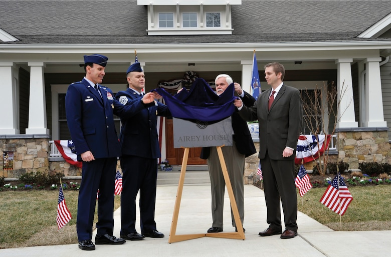 "Colonel Steven Shepro (from left), Joint Base Andrews and 316th Wing commander; Chief Master Sgt. of the Air Force James A. Roy; retired Chief Master Sgt. Dale Airey; and Mike Dowling, a representative of Clark Realty, unveil a plaque during a dedication ceremony March 10, 2010, at 1 Airey Court, Joint Base Andrews, Md.  The chief master sergeant of the Air Force's new quarters, now ""Airey House,"" were dedicated to the first chief master sergeant of the Air Force, Paul W. Airey.  (U.S. Air Force photo/ Airman 1st Class Perry Aston)"