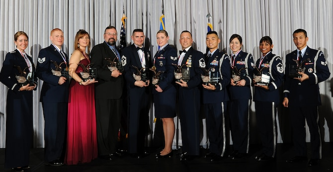 The winners of the 2009 Air Force Academy Awards are (left to right): Capt. Michelle Ruehl (company grade officer), Staff Sgt. Michael Clinkscales (NCO), Pamela Batzel (civilian category I), Erich Hoffmann (civilian category II), Senior Master Sgt. Roderick Schwald (first sergeant), Senior Airman Jessica Morehouse (Airman), Master Sgt. Robert Pemberton (senior NCO), Maj. Robert Bonner (Honor Guard officer), Staff Sgt. Michiyo Litynski (Honor Guard NCO), Master Sgt. Lissy Slezak (Honor Guard senior NCO) and Senior Airman Nhan Le (Honor Guard Airman). Not pictured is Keith Butala, the civilian category III winner. (U.S. Air Force photo/Rachel Boettcher)