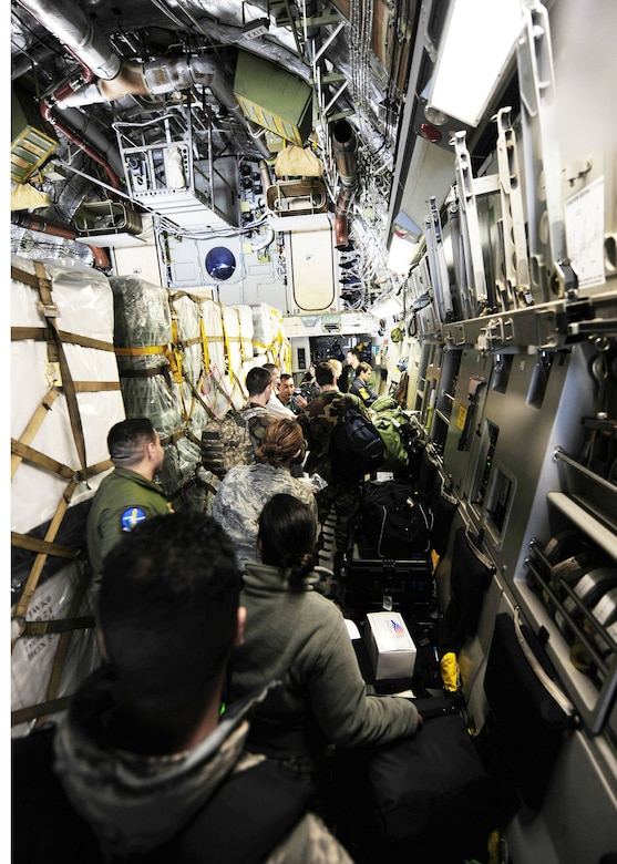 Airmen load onto a C-17 Globemaster III awaiting departure March 8, 2010, from Lackland Air Force Base, Texas. The Airmen are part of an Air Force Expeditionary Medical Support team that deployed to Angol, Chile, to augment medical care for more than 110,000 Chileans in the region. (U.S. Air Force photo/Senior Airman Tiffany Trojca)