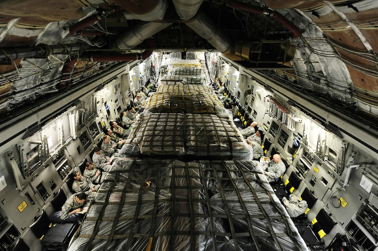 Airmen sit on a C-17 Globemaster III awaiting departure March 8, 2010, from Lackland Air Force Base, Texas. The Airmen are part of an Air Force Expeditionary Medical Support team that deployed to Angol, Chile, to augment medical care for more than 110,000 Chileans in the region. (U.S. Air Force photo/Senior Airman Tiffany Trojca)