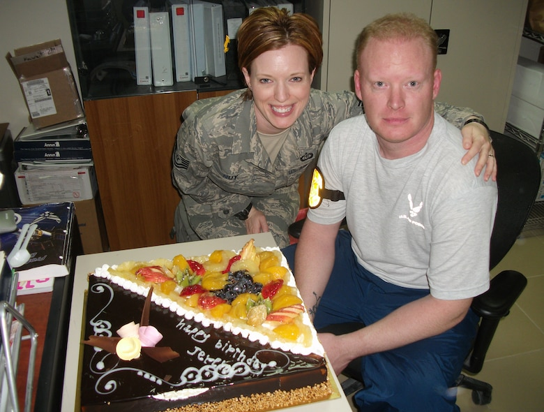 Tech. Sgt. Jennifer Nuy, 386th Expeditionary Operations Group weather flight chief, and her big brother, Staff Sgt. Jeremy Pickens, 817th Expeditionary Airlift Squadron C-17 loadmaster, celebrate their birthdays together Feb.  25, 2010 at an air base in Southwest Asia. The siblings, both Union Town, Ohio, natives, were together on their birthdays for the first time in 16 years. Sergeant Nuy is assigned to the 43rd Operations Support Squadron at Pope Air Force Base, N.C. and Sergeant Pickens is assigned to the 21st Airlift Squadron at Travis AFB, Calif. (U.S. Air Force photo/Released)
