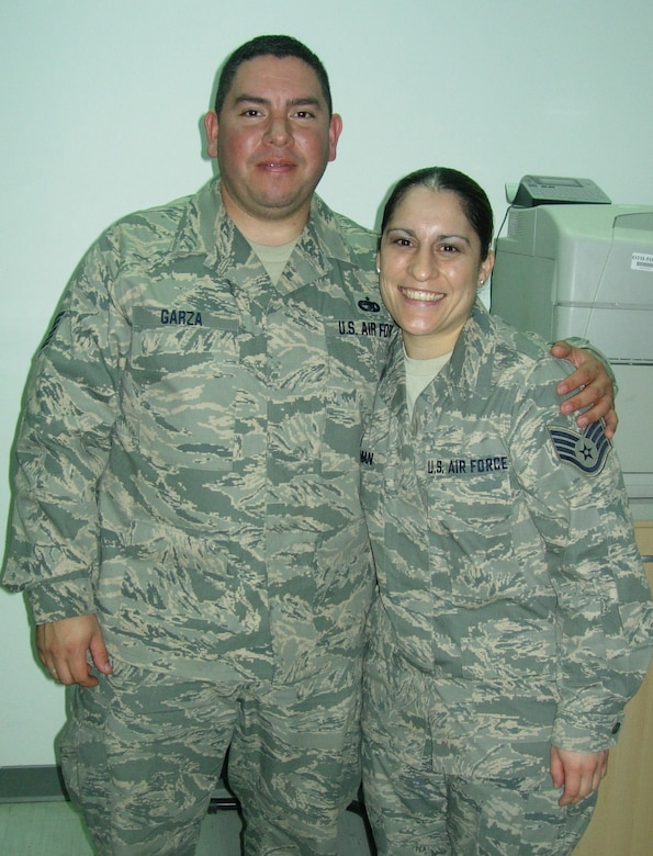 U.S. Air Force Tech. Sgt. Ramiro Orlando Garza, 506th Expeditionary Logistics Readiness Squadron vehicle operator, spends time with his little sister Staff Sgt. Christine Marie Roman, 386th Logistics Readiness Squadron logistics planner, Feb. 11, 2010 at an air base in Southwest Asia while transiting through the base to Iraq. Sergeant Roman is deployed from the Global Strike Command at Barksdale Air Force Base, La. and Sergeant Garza is deployed from the 433rd Logistics Readiness Squadron at Lackland AFB, Texas. Teh siblings are natives of San Antonio, Texas. (U.S. Air Force photo/Released)