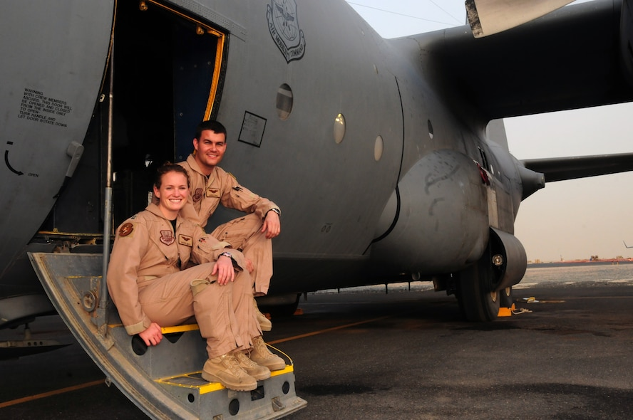 U.S. Air Force Capts. Regina and Jared Wall, C-130 pilots with the 39th Airlift Squadron at Dyess Air Force Base, Texas, are serving on their second deployment together with the 737th Expeditionary Airlift Squadron at an air base in Southwest Asia. (U.S. Air Force photo by Staff Sgt. Lakisha A. Croley/Released)