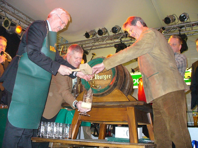 City and Bitburg Brewery officials, along with some invited guests, tap the first keg of beer during the opening ceremonies of the Bitburg Bier festival. (U.S. Air Force photo/Iris Reiff)