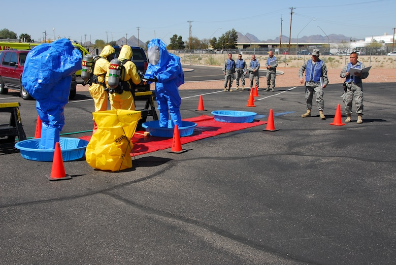 First responders from the base fire station go through a decontamination line after containing a simulated hazardous material spill March 12 as part of a compliance inspection exercise. The 162nd Fighter Wing at Tucson International Airport is hosting an inspection team from Air Education and Training Command March 10-16. (Air Force photo by Master Sgt. Dave Neve)