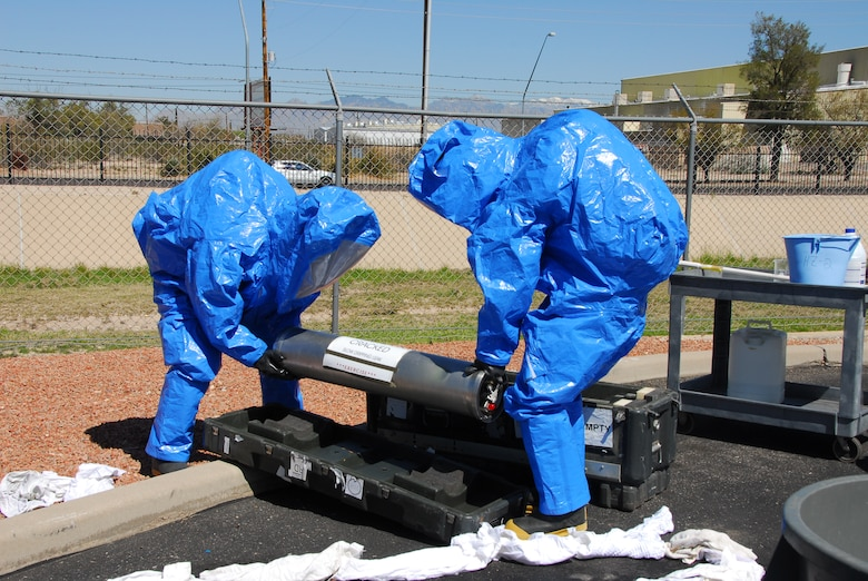 First responders from the base fire station contain a simulated hazardous material spill March 12 as part of a compliance inspection exercise. The 162nd Fighter Wing at Tucson International Airport is hosting an inspection team from Air Education and Training Command March 10-16. (Air Force photo by Master Sgt. Dave Neve)