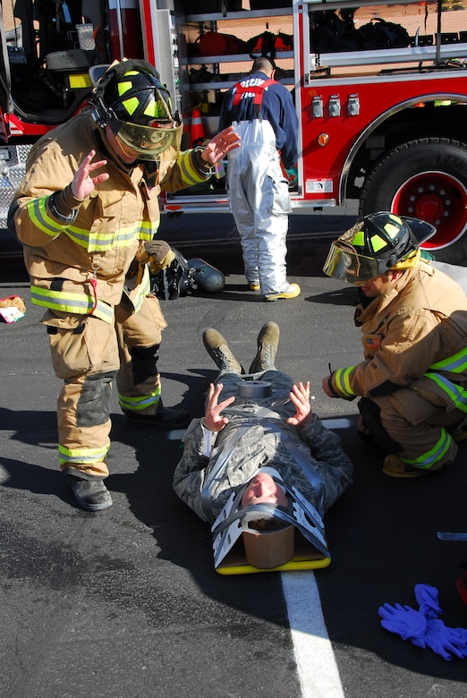 First responders from the base fire station secure an injured Guardsman during a simulated accident March 12 as part of a compliance inspection exercise. The 162nd Fighter Wing at Tucson International Airport is hosting an inspection team from Air Education and Training Command March 10-16. (Air Force photo by Master Sgt. Dave Neve)