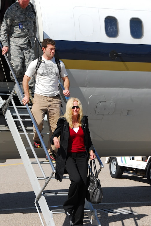 Lt. Col. (ret) Christine Shearouse, from the inspection team's contingency branch, arrives on the flightline at Tucson International Airport, March 10. Colonel Shearouse and an inspection team from Air Education and Training Command visited the Arizona Air Guard fighter wing for a compliance inspection this month.