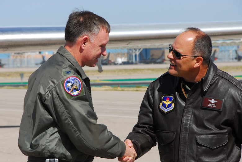 Col. Brian Akins, 19th Air Force Guard Advisor, is greeted by Brig. Gen. Greg Stroud, 162nd Fighter Wing commander, on the flightline at Tucson International Airport, March 10. Colonel Akins and an inspection team from Air Education and Training Command visited the Arizona Air Guard fighter wing for a compliance inspection this month.