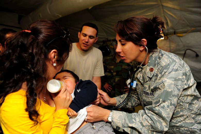 Major Deena Sutter, 59th Medical Wing at Lackland Air Force Base, Texas, checks the heartbeat of an ill child March 14, 2010, in Angol, Chile. Airmen from an Air Force Expeditionary Medical Support team along with members of the Chilean army built a mobile hospital here to help augment medical services for nearly 110,000 Chileans in the region.
