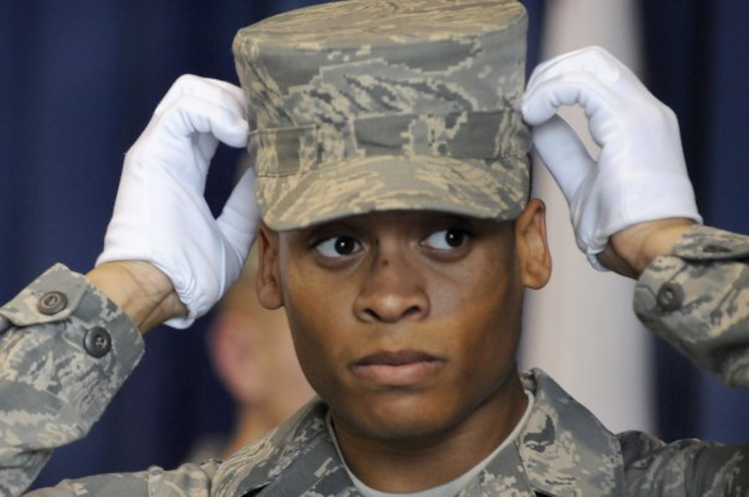 U.S. Air Force Airman 1st Class William Nealey III, United States Air Force Honor Guard technical school trainee, adjusts his hat during practice, Feb. 22, 2010, inside the Honor Guard's C Hall on Bolling Air Force Base, D.C. Throughout technical school, trainees will need to pass four evaluations in order to become a member of the honor guard.  (U.S. Air Force photo by Senior Airman Marleah Miller)