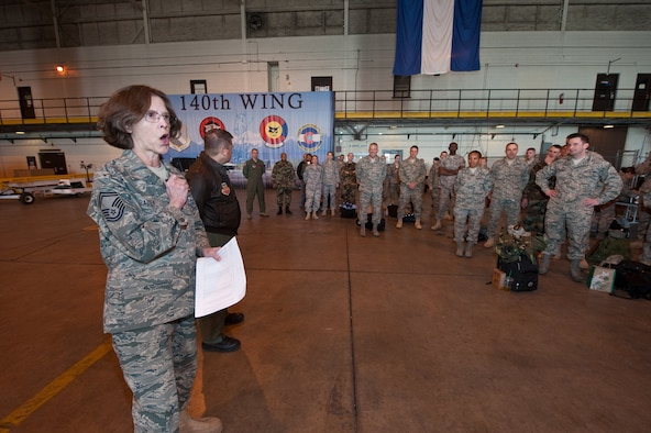 """Senior Master Sgt. Linda Baden, Health Services Manager for the Colorado Air National Guard's 140th Medical Group, Buckley Air Force Base, turns over control of personnel to U.S. Air Force Lt. Col. Paul Shingledecker, Commander, 140th Medical Group, March 13, 2010. Shingledecker is leading a more than 60-person team supporting the Office of the Assistant Secretary of Defense for Reserve Affairs Innovative Readiness Training Program E Malama Kakou (translated from Hawaiian as """"to care for all""""). (U.S. Air Force photo/Master Sgt. John Nimmo, Sr.) (RELEASED)"""