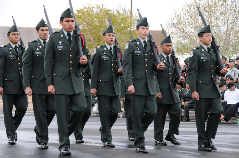 An Army Junior ROTC drill team marches onto the drill pad to perform during a drill team competition at the base February 20, 2010. This is the tenth annual competition hosted by the 161st Air Refueling Wing. (U.S. Air Force Photo by Senior Airman Nicole Enos)