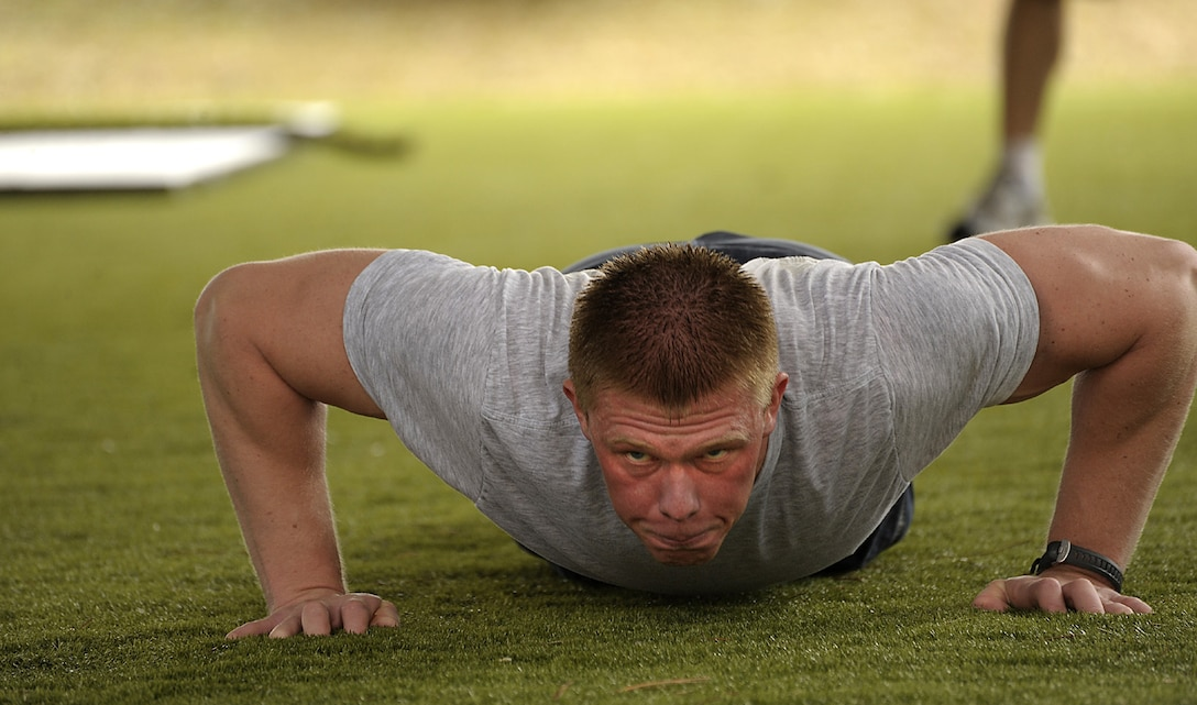 Senior Airman Matthew Sattler, 4th Aircraft Maintenance Unit, performs push-ups during the Physical Ability Stamina Test held March 12 at Hurlburt Field, Fla.  Hosted by the Air Force Special Operations Training Center, candidates had to pass every element of the PAST to qualify for combat control, pararescue, special operations weather or the combat rescue officer career fields.  (U.S. Air Force photo by Master Sgt. Russell E. Cooley IV) (Released)